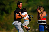 Jason Day of Australia celebrates on the 18th green with his son Dash and wife Ellie after winning the 2015 PGA Championship with a score of 20under...