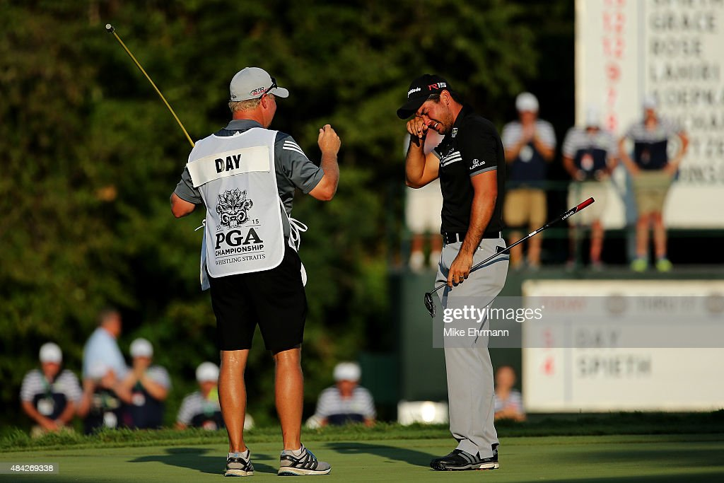 Jason Day of Australia celebrates with his caddie Colin Swatton on the 18th green after winning the 2015 PGA Championship with a score of 20-under par at Whistling Straits on August 16, 2015 in Sheboygan, Wisconsin.