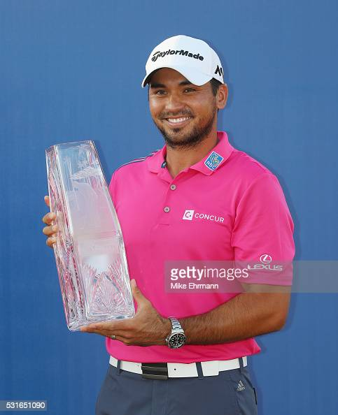 Jason Day of Australia celebrates with the trophy after winning during the final round of THE PLAYERS Championship at the Stadium course at TPC...