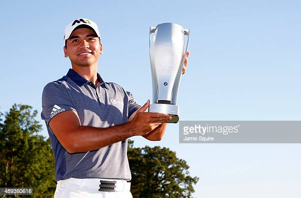 Jason Day of Australia celebrates with the winner's trophy after the Final Round of the BMW Championship at Conway Farms Golf Club on September 20...