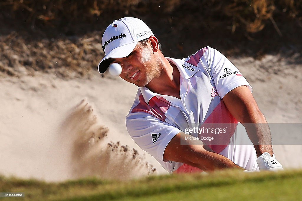 <a gi-track='captionPersonalityLinkClicked' href=/galleries/search?phrase=Jason+Day+-+Golfer&family=editorial&specificpeople=4534484 ng-click='$event.stopPropagation()'>Jason Day</a> of Australia chips out of a bunker during day one of the World Cup of Golf at Royal Melbourne Golf Course on November 21, 2013 in Melbourne, Australia.
