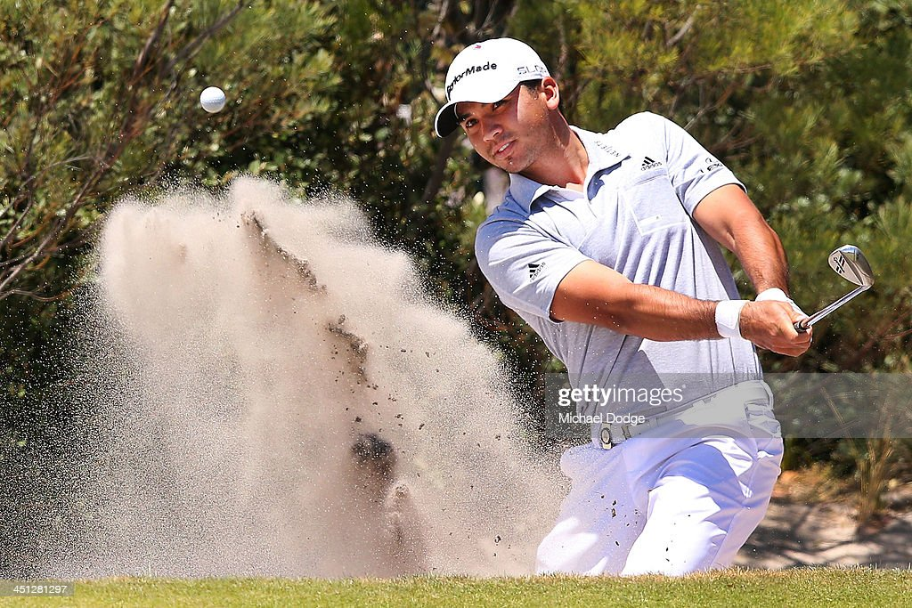 <a gi-track='captionPersonalityLinkClicked' href=/galleries/search?phrase=Jason+Day+-+Golfer&family=editorial&specificpeople=4534484 ng-click='$event.stopPropagation()'>Jason Day</a> of Australia chips out of the bunker during day two of the World Cup of Golf at Royal Melbourne Golf Course on November 22, 2013 in Melbourne, Australia.