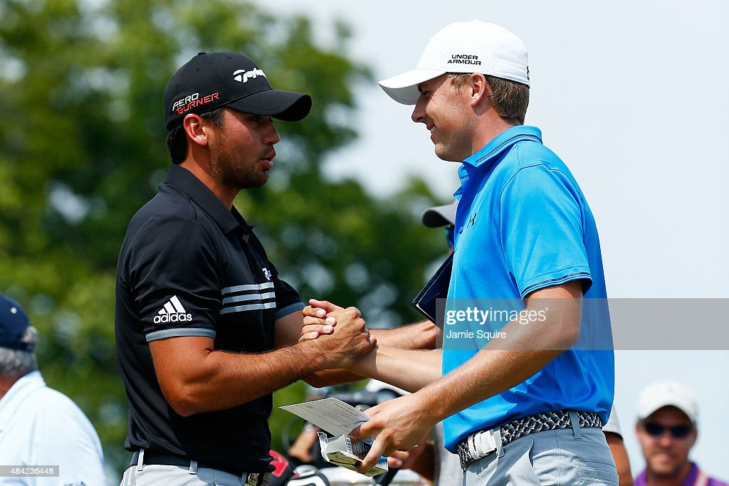 Jason Day of Australia greets Jordan Spieth of the United States on the first tee during the final round of the 2015 PGA Championship at Whistling...
