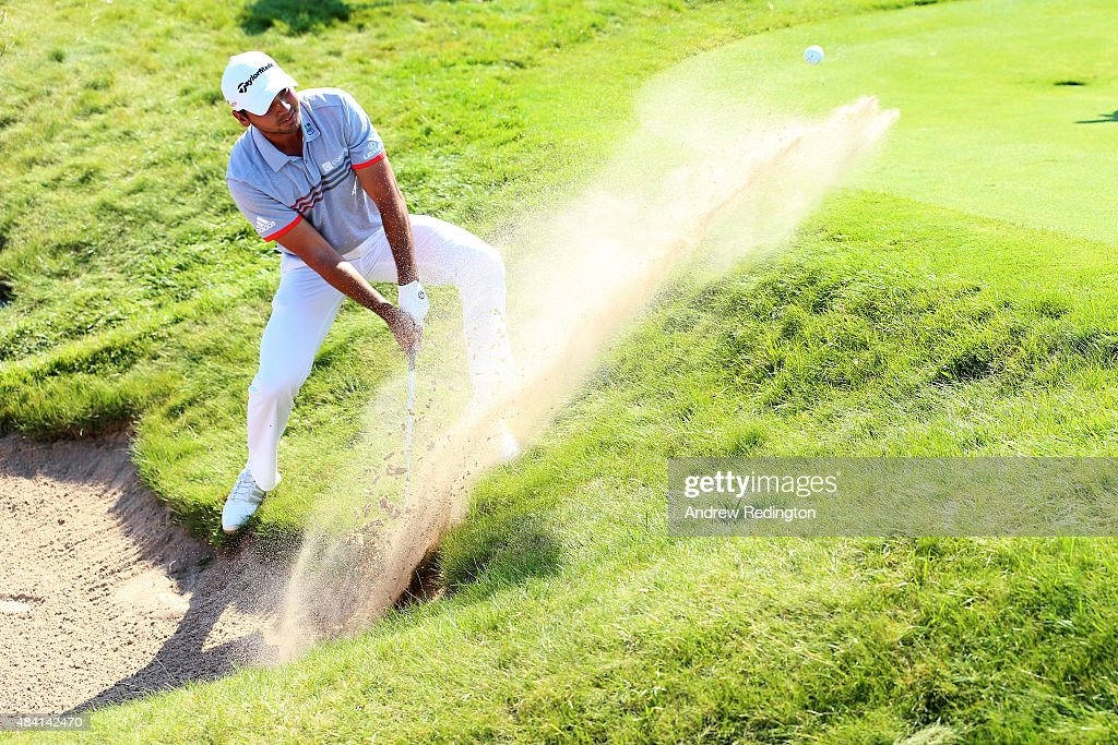 Jason Day of Australia hits a bunker shot on the second hole during the third round of the 2015 PGA Championship at Whistling Straits on August 15...