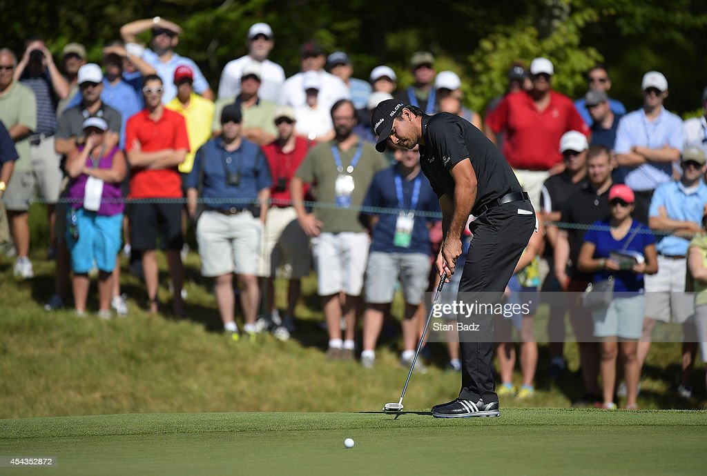 <a gi-track='captionPersonalityLinkClicked' href=/galleries/search?phrase=Jason+Day+-+Golfer&family=editorial&specificpeople=4534484 ng-click='$event.stopPropagation()'>Jason Day</a> of Australia hits a putt on the 13th hole during the first round of the Deutsche Bank Championship at TPC Boston on August 29, 2014 in Norton, Massachusetts.
