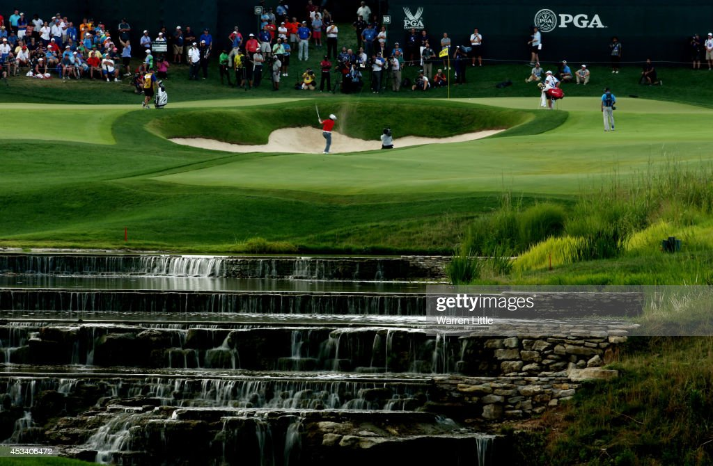 <a gi-track='captionPersonalityLinkClicked' href=/galleries/search?phrase=Jason+Day+-+Golfer&family=editorial&specificpeople=4534484 ng-click='$event.stopPropagation()'>Jason Day</a> of Australia hits a shot from a greenside bunker on the 18th hole during the third round of the 96th PGA Championship at Valhalla Golf Club on August 9, 2014 in Louisville, Kentucky.