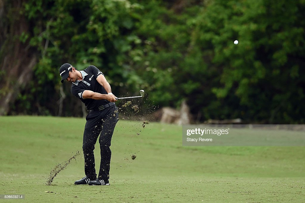 Jason Day of Australia hits his approach shot on the 16th hole during a continuation of the second round of the Zurich Classic at TPC Louisiana on April 30, 2016 in Avondale, Louisiana.