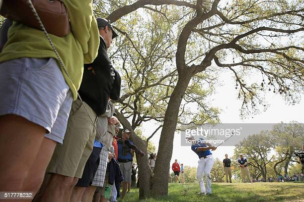 Jason Day of Australia hits his second shot from the rough on the 18th hole during his semifinal match with Rory McIlroy at the World Golf...