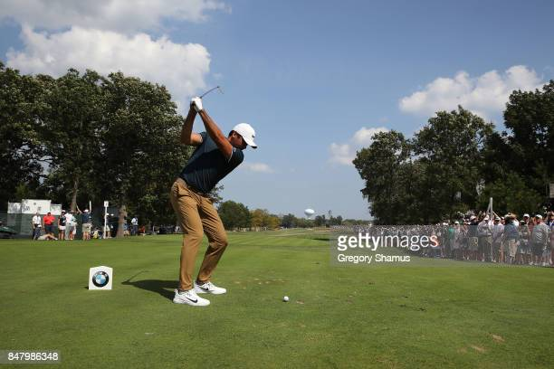 Jason Day of Australia hits his tee shot on the third hole during the third round of the BMW Championship at Conway Farms Golf Club on September 16...