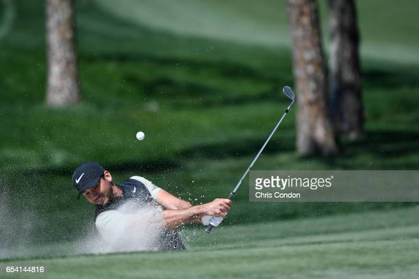 Jason Day of Australia hits his third from the bunker at No 5 during the first round of the Arnold Palmer Invitational presented by MasterCard at Bay...
