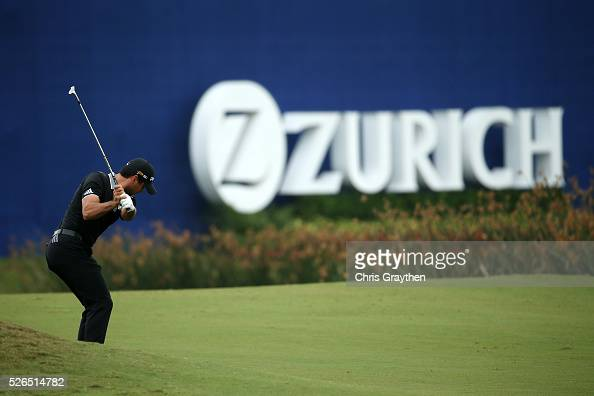 Jason Day of Australia hits his third shot on the 18th hole during the continuaiton of the second round of the Zurich Classic of New Orleans at TPC...