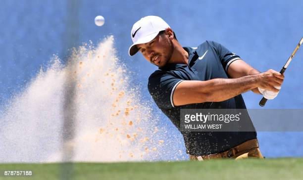 Jason Day of Australia hits out of a bunker during the third round of the Australian Open played at the Australian Golf Club course in Sydney on...