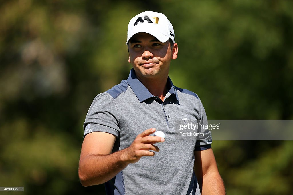 Jason Day of Australia holds up his ball after putting on the sixth green during the Final Round of the BMW Championship at Conway Farms Golf Club on...