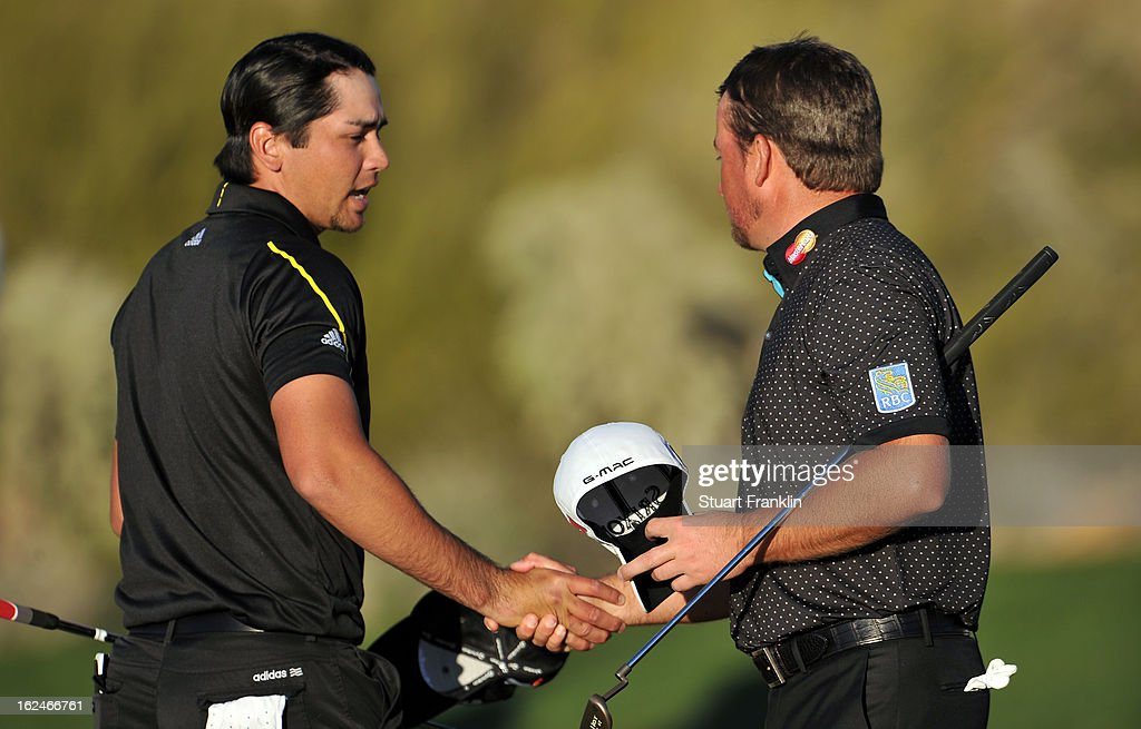 Jason Day of Australia is congratulated by Graeme McDowell of Northern Ireland after Day won their match 1 up in 18 holes during the quarterfinal round of the World Golf Championships - Accenture Match Play at the Golf Club at Dove Mountain on February 23, 2013 in Marana, Arizona.