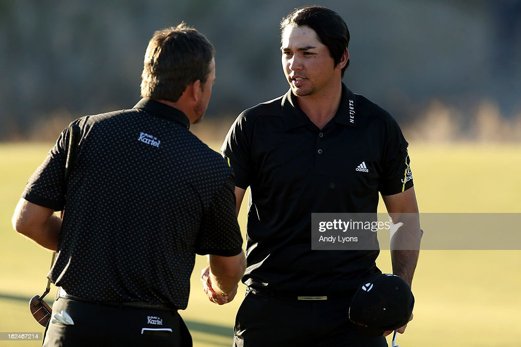 Jason Day (R) of Australia is congratulated by Graeme McDowell of Northern Ireland after Day won their match 1 up in 18 holes during the quarterfinal round of the World Golf Championships - Accenture Match Play at the Golf Club at Dove Mountain on February 23, 2013 in Marana, Arizona.