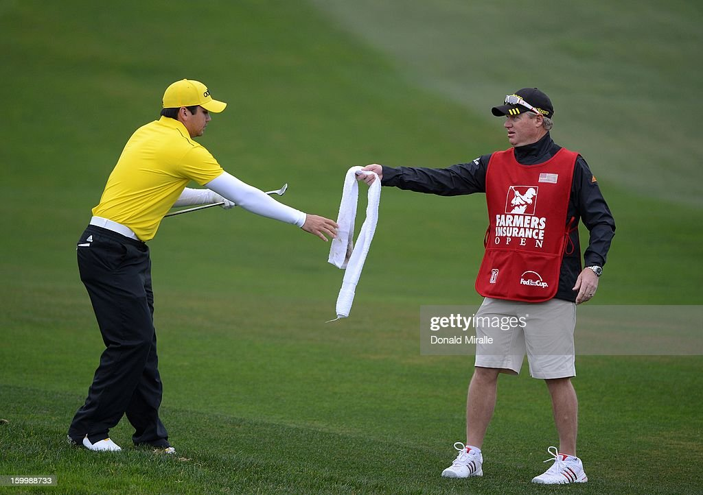 Jason Day (L) of Australia is handed a towel from his caddie during the First Round at the Farmers Insurance Open at Torrey Pines Golf Course on January 24, 2013 in La Jolla, California.