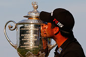 Jason Day of Australia kisses the Wanamaker trophy after winning the 2015 PGA Championship with a score of 20under par at Whistling Straits on August...