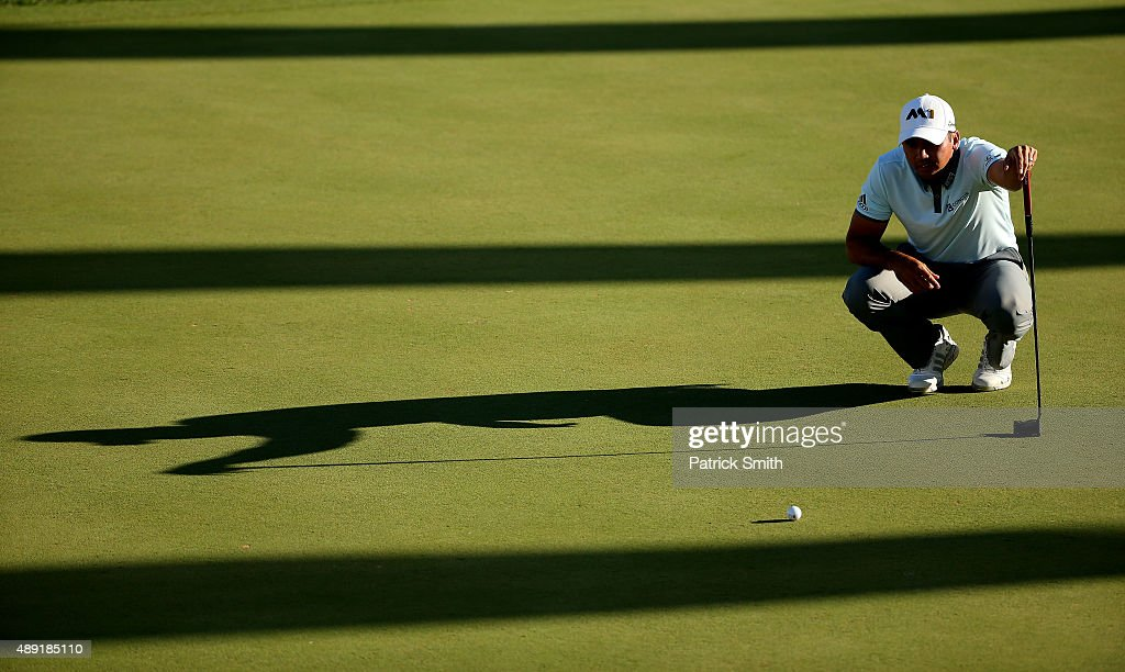 Jason Day of Australia lines up a putt on the 18th green during the Third Round of the BMW Championship at Conway Farms Golf Club on September 19, 2015 in Lake Forest, Illinois.