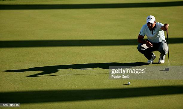Jason Day of Australia lines up a putt on the 18th green during the Third Round of the BMW Championship at Conway Farms Golf Club on September 19...