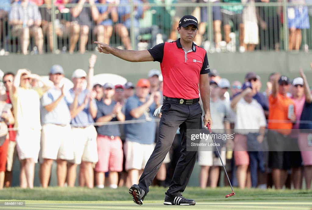 Jason Day of Australia makes a putt for birdie on the 14th hole during the second round of the 2016 PGA Championship at Baltusrol Golf Club on July 29, 2016 in Springfield, New Jersey.