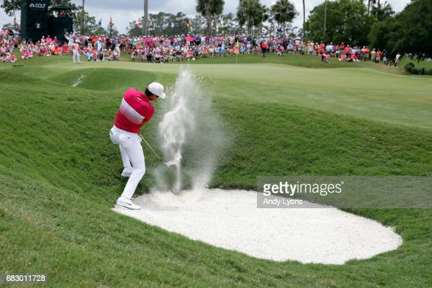 Jason Day of Australia plays a shot from a bunker on the second hole during the final round of THE PLAYERS Championship at the Stadium course at TPC...