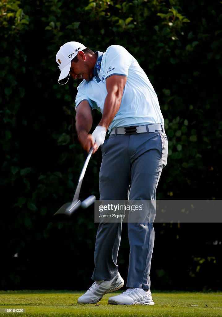 Jason Day of Australia plays a shot from the 13th tee during the Third Round of the BMW Championship at Conway Farms Golf Club on September 19, 2015 in Lake Forest, Illinois.