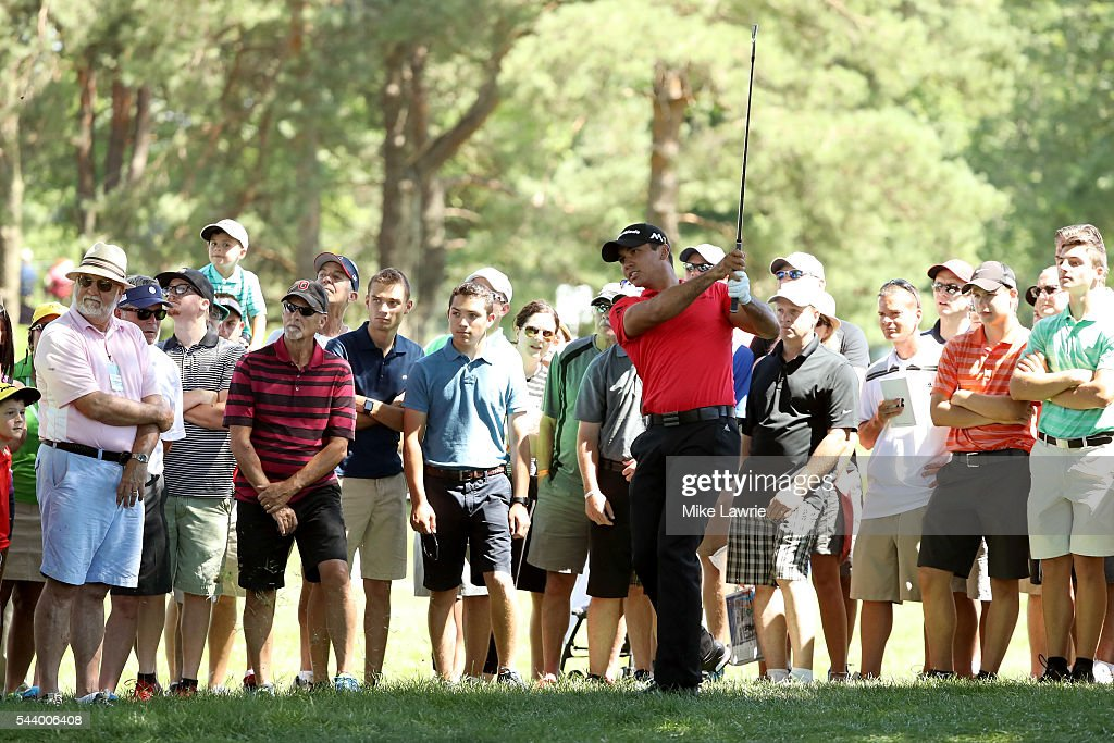 Jason Day of Australia plays a shot on the 16th hole during the first round of the World Golf Championships - Bridgestone Invitational at Firestone Country Club South Course on June 30, 2016 in Akron, Ohio.