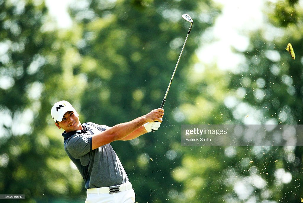Jason Day of Australia plays a shot on the first hole during the Final Round of the BMW Championship at Conway Farms Golf Club on September 20 2015...