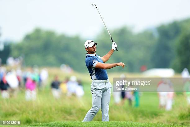 Jason Day of Australia plays a shot on the first hole during the continuation of the weather delayed first round of the US Open at Oakmont Country...