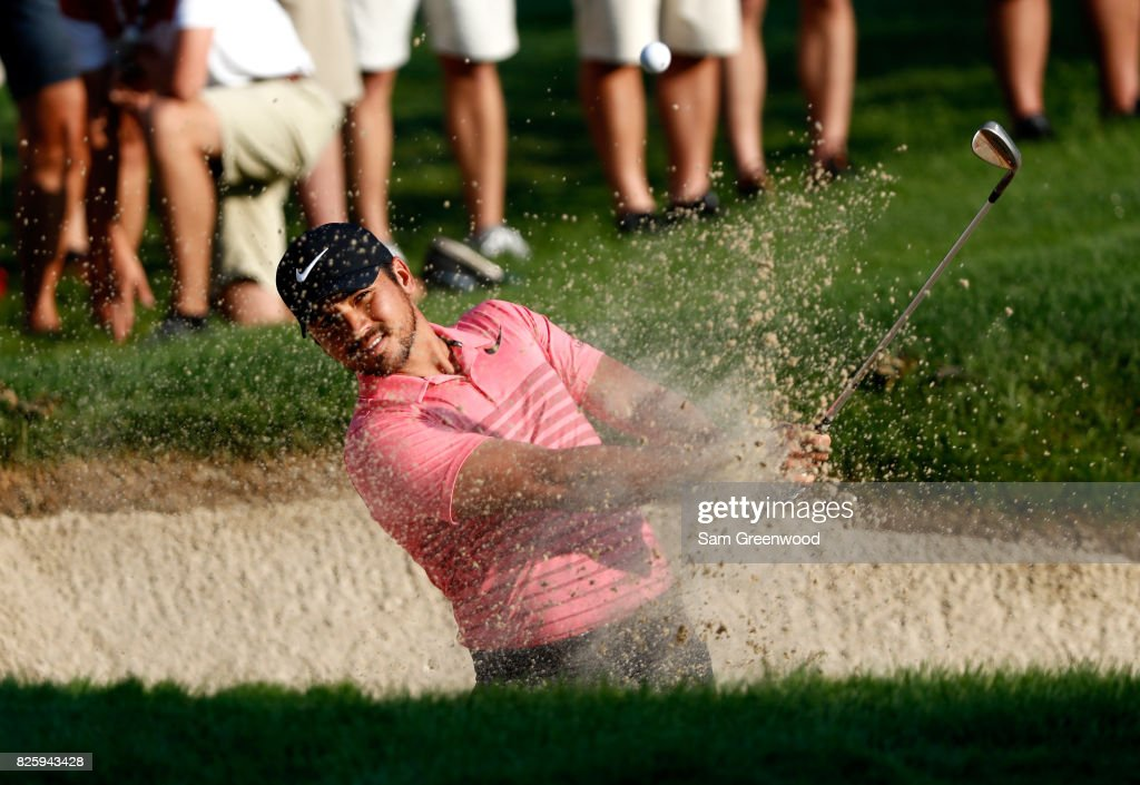 Jason Day of Australia plays a shot out of a bunker on the tenth hole during the first round of the World Golf Championships - Bridgestone Invitational at Firestone Country Club South Course on August 3, 2017 in Akron, Ohio.