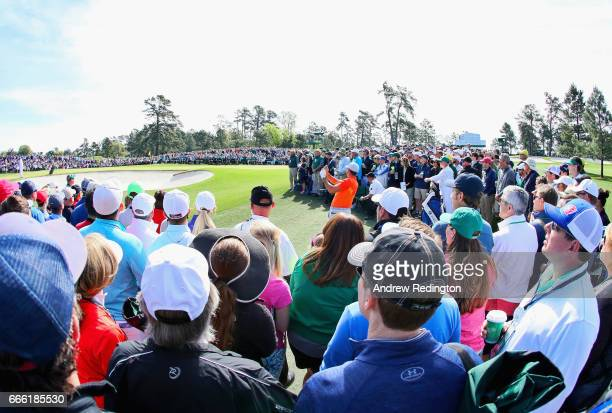 Jason Day of Australia plays a shot to the second green as patrons look on during the third round of the 2017 Masters Tournament at Augusta National...