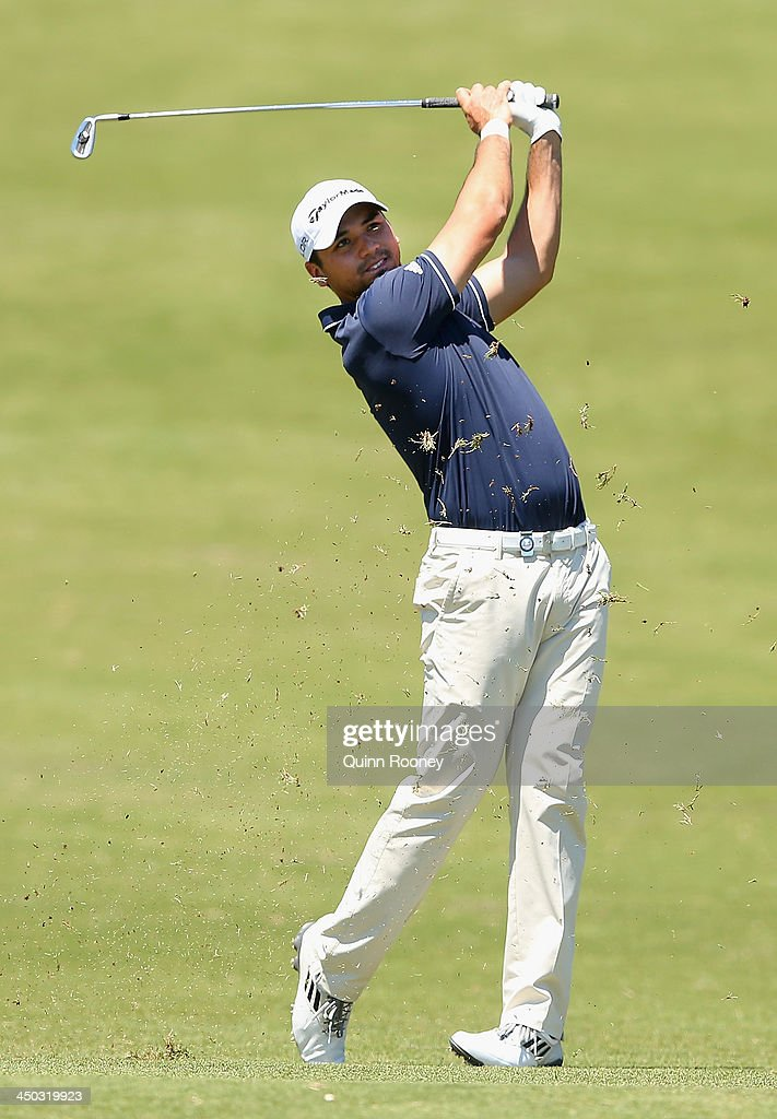 Jason Day of Australia plays an approach shot during practice ahead of the World Cup Of Golf at Royal Melbourne Golf Course on November 18, 2013 in Melbourne, Australia.