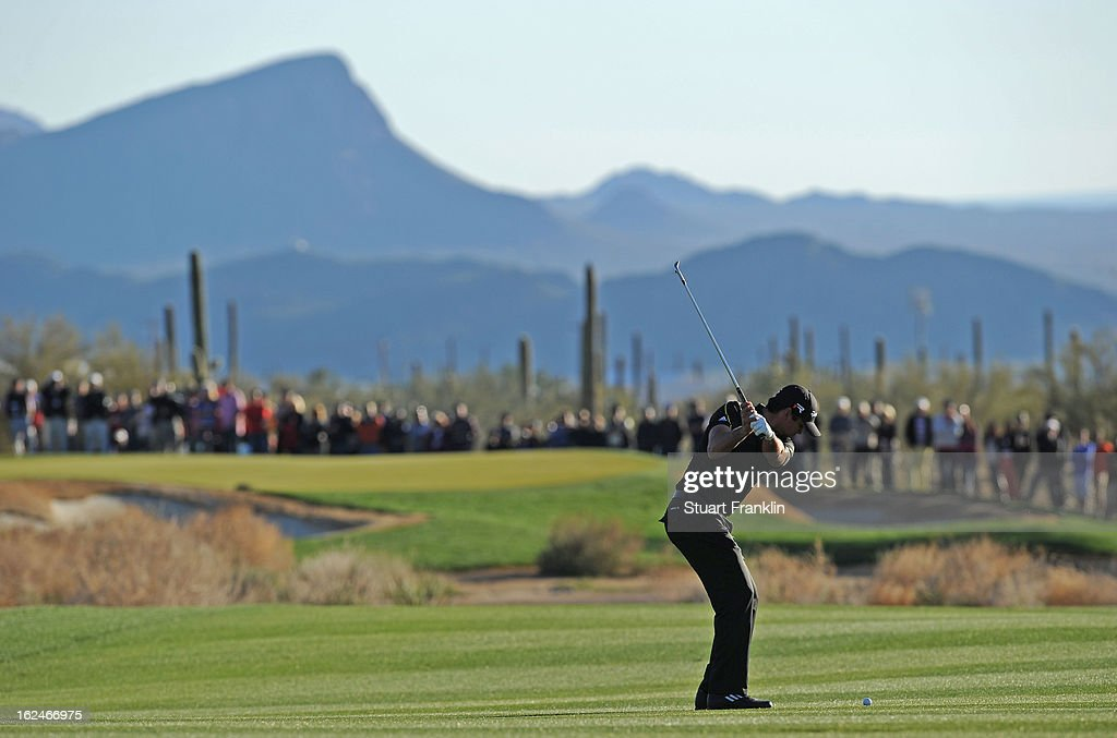 Jason Day of Australia plays his approach shot on the 17th hole during the quarterfinal round of the World Golf Championships - Accenture Match Play at the Golf Club at Dove Mountain on February 23, 2013 in Marana, Arizona.