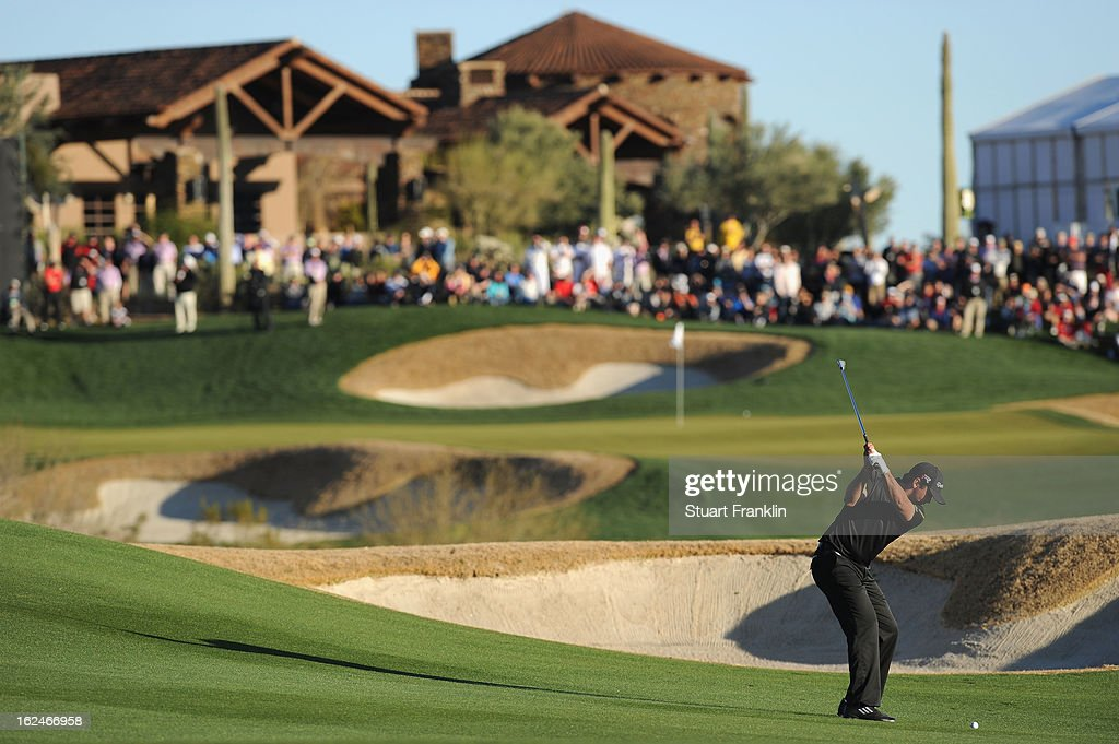 Jason Day of Australia plays his approach shot on the 18th hole during the quarterfinal round of the World Golf Championships Accenture Match Play at...