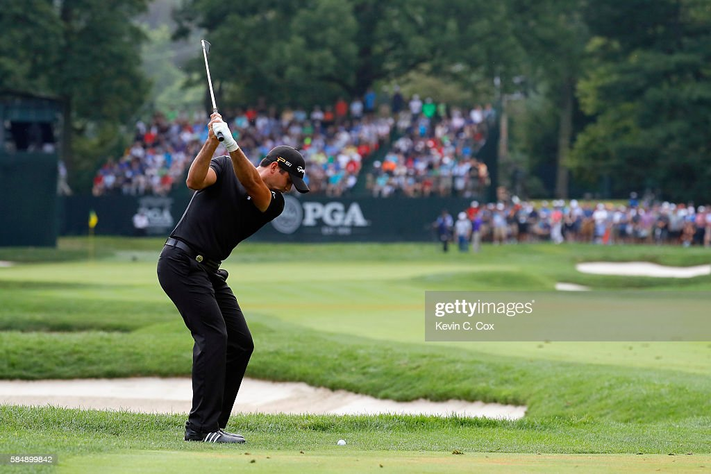 Jason Day of Australia plays his second shot on the 13th hole during the final round of the 2016 PGA Championship at Baltusrol Golf Club on July 31...