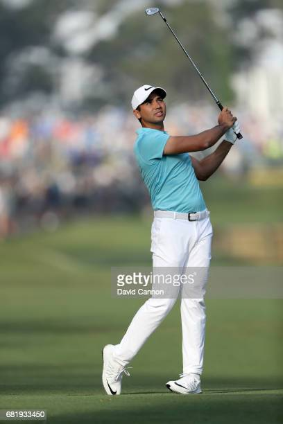 Jason Day of Australia plays his second shot on the par 4 10th hole during the first round of THE PLAYERS Championship on the Stadium Course at TPC...