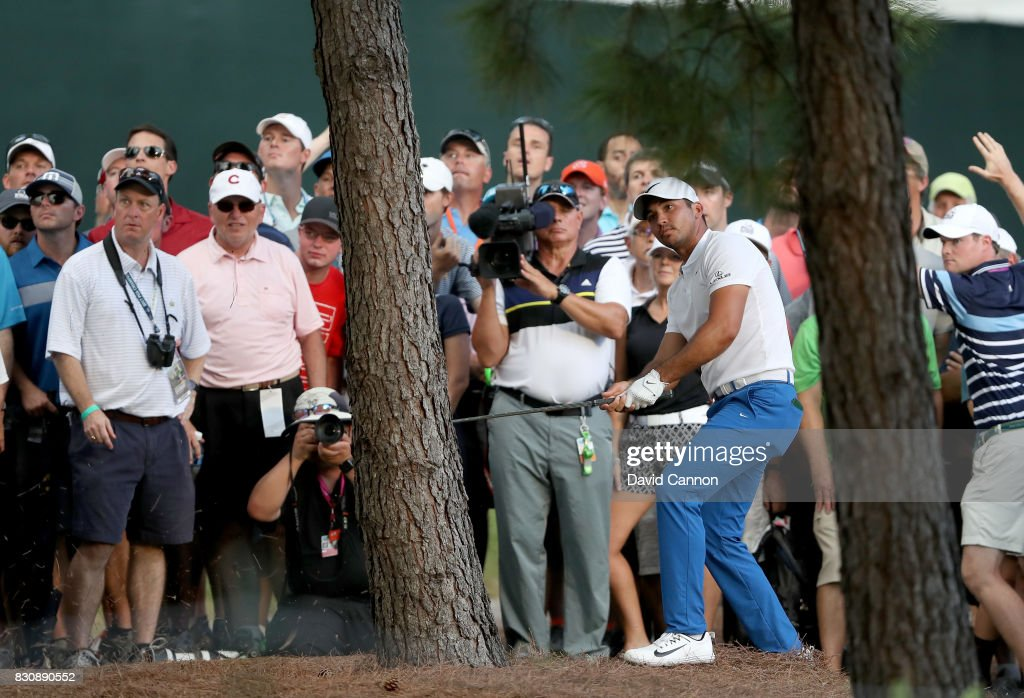 Jason Day of Australia plays his second shot on the par 4, 18th hole during the third round of the 2017 PGA Championship at Quail Hollow on August 12, 2017 in Charlotte, North Carolina.