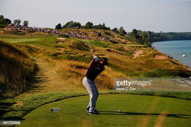 Jason Day of Australia plays his shot from the 13th tee during the final round of the 2015 PGA Championship at Whistling Straits on August 16 2015 in...