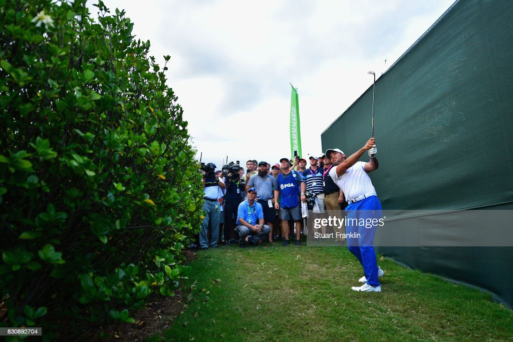 Jason Day of Australia plays his shot from the rough on the 18th hole during the third round of the 2017 PGA Championship at Quail Hollow Club on August 12, 2017 in Charlotte, North Carolina.