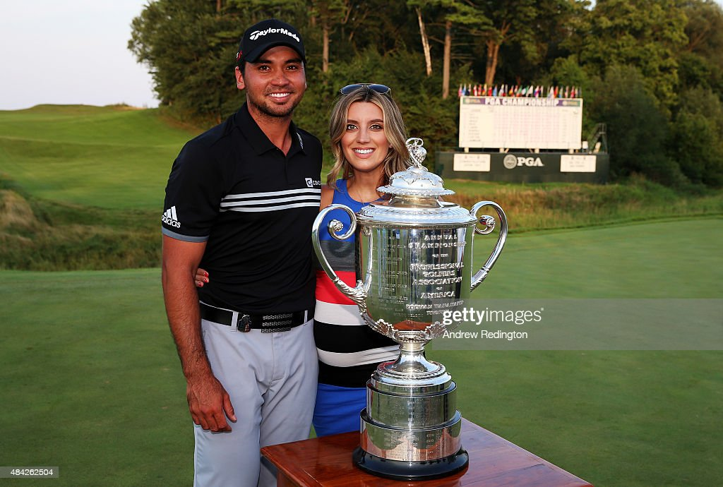 Jason Day of Australia poses with his wife and the Wanamaker Trophy after winning the 2015 PGA Championship with a score of 20-under par at Whistling Straits on August 16, 2015 in Sheboygan, Wisconsin.