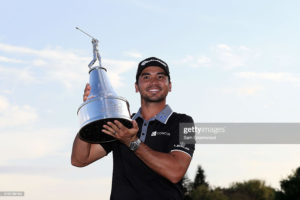 Jason Day of Australia poses with the trophy following the final round of the Arnold Palmer Invitational Presented by MasterCard at Bay Hill Club and Lodge on March 20, 2016 in Orlando, Florida.