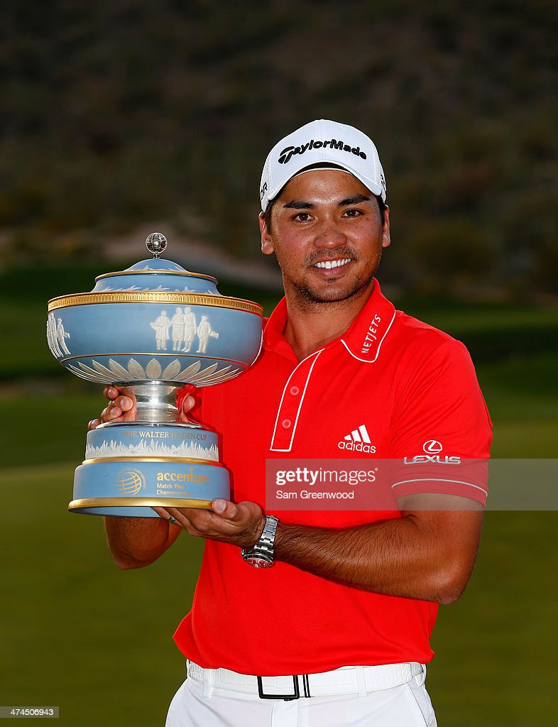 Jason Day of Australia poses with the Walter Hagen Cup after defeating Victor Dubuisson of France on the 23rd hole of the World Golf Championships...
