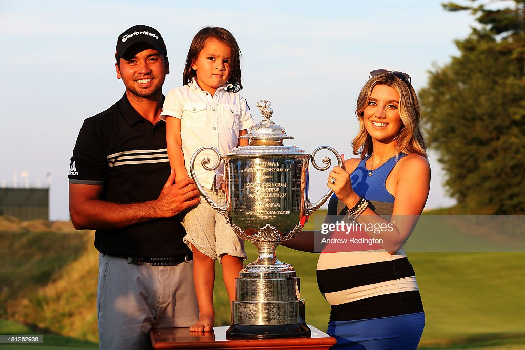 Jason Day of Australia poses with the Wanamaker Trophy and his wife Ellie and son Dash after winning the 2015 PGA Championship with a score of 20-under par at Whistling Straits on August 16, 2015 in Sheboygan, Wisconsin.