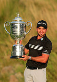 Jason Day of Australia proudly holds the Wanamaker Trophy after his victory with a record Major score of 20 under par during the final round of the...