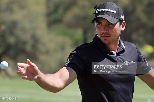Jason Day of Australia reaches for a golf balll on the practice ground during the second round of the World Golf ChampionshipsDell Match Play at the...