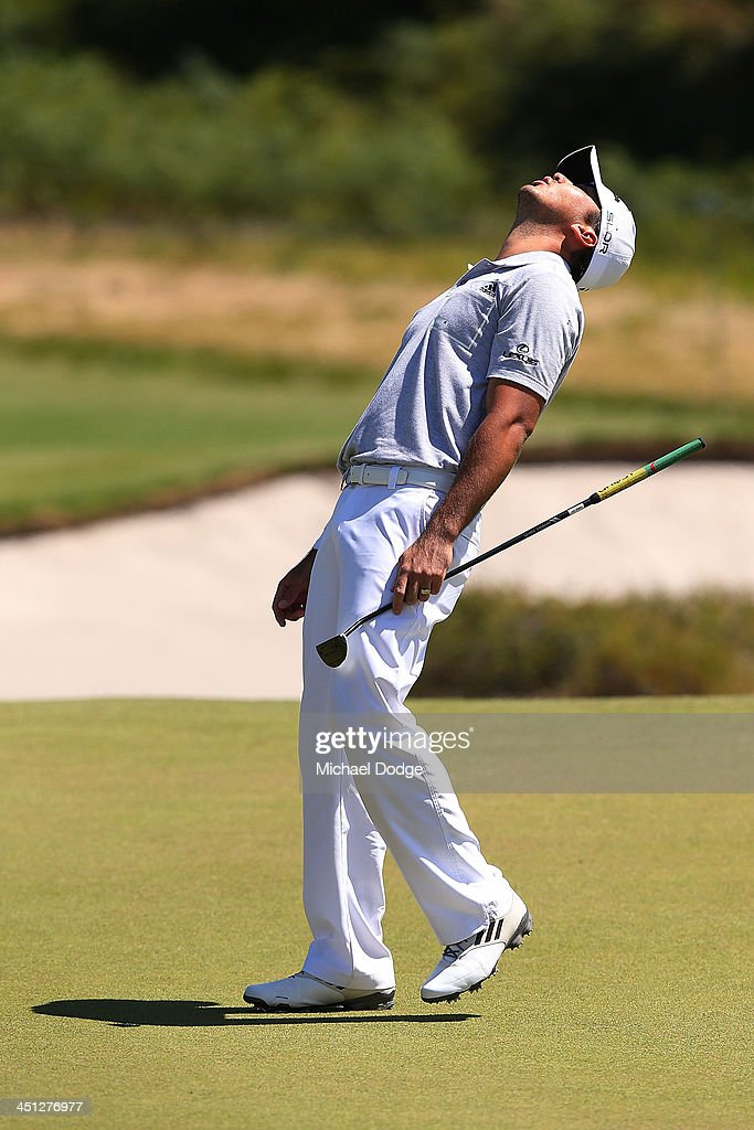 <a gi-track='captionPersonalityLinkClicked' href=/galleries/search?phrase=Jason+Day+-+Golfer&family=editorial&specificpeople=4534484 ng-click='$event.stopPropagation()'>Jason Day</a> of Australia reacts after missing a birdie putt on the 13th hole during day two of the World Cup of Golf at Royal Melbourne Golf Course on November 22, 2013 in Melbourne, Australia.