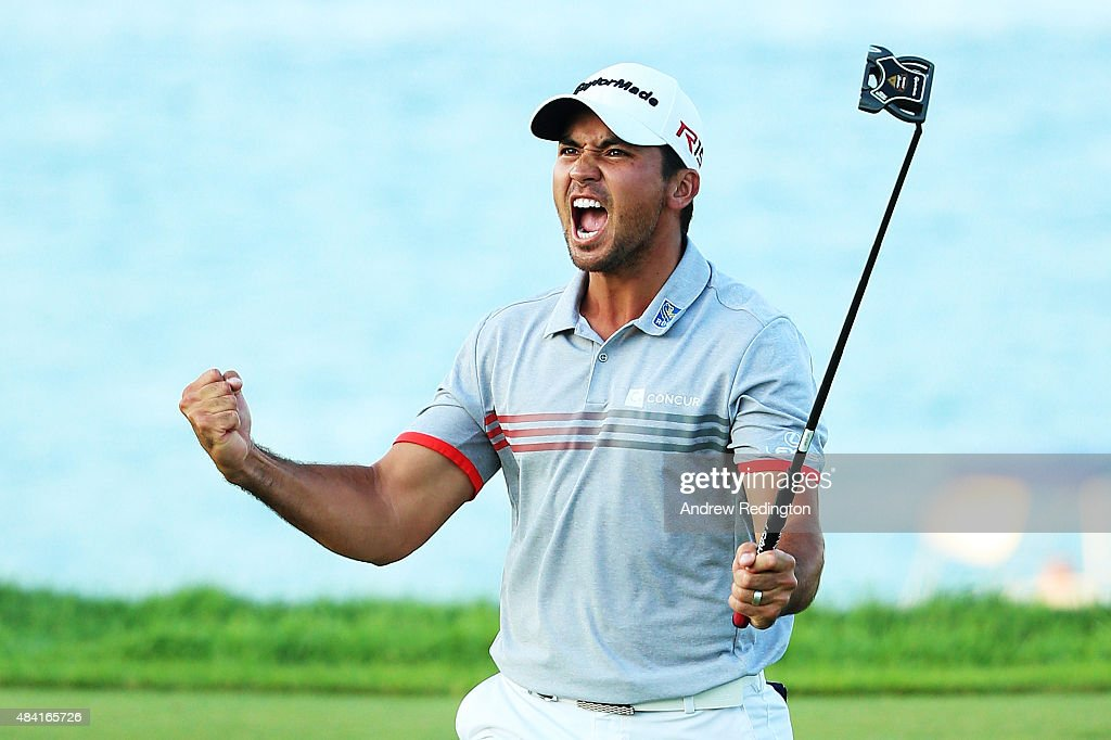 Jason Day of Australia reacts after sinking a putt on the 17th green during the third round of the 2015 PGA Championship at Whistling Straits at on August 15, 2015 in Sheboygan, Wisconsin.