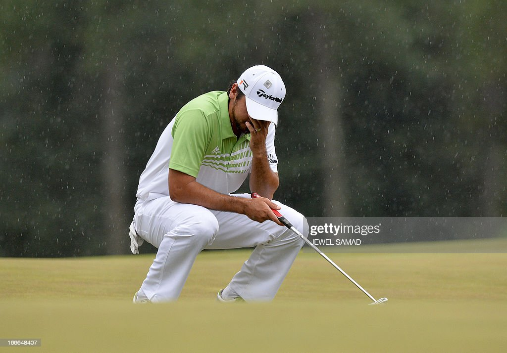 <a gi-track='captionPersonalityLinkClicked' href=/galleries/search?phrase=Jason+Day+-+Golfer&family=editorial&specificpeople=4534484 ng-click='$event.stopPropagation()'>Jason Day</a> of Australia reacts on the 18th green during the fourth round at 77th Masters golf tournament at Augusta National Golf Club on April 14, 2013 in Augusta, Georgia. Adam Scott of Australia sank a 10-foot birdie putt on the second playoff hole Sunday to beat Angel Cabrera and win the 77th Masters, becoming the first Australian golfer to capture the green jacket. AFP PHOTO/Jewel Samad