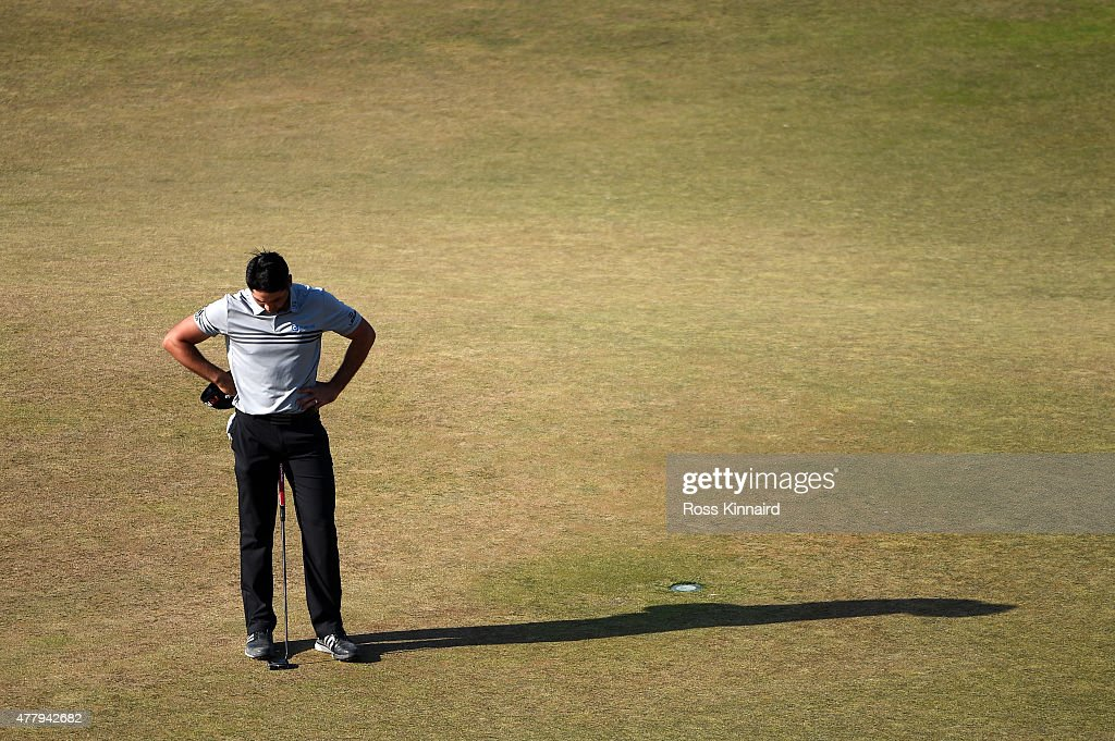 Jason Day of Australia reacts on the 18th green during the third round of the 115th U.S. Open Championship at Chambers Bay on June 20, 2015 in University Place, Washington.