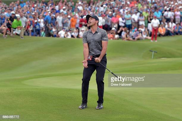 Jason Day of Australia reacts to a missed putt in a playoff against Billy Horschel on the 18th hole during the Final Round of the ATT Byron Nelson at...